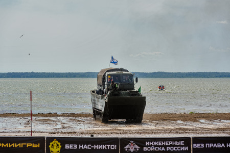 tracked: Tyumen, Russia - June 23, 2017: Army Games. Engineering Formula contest. Highest military and engineering school ground. Equipment transportation across a water obstacle tracked amphibious carrier PTS and overcoming ford