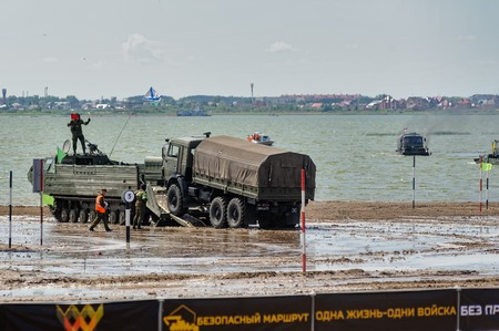 Tyumen, Russia - June 23, 2017: Army Games. Engineering Formula contest. Highest military and engineering school ground. Equipment transportation across a water obstacle tracked amphibious carrier PTS