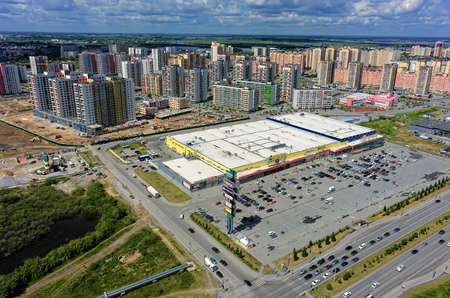Tyumen, Russia - June 13, 2017: Aerial view onto Zeleniy Bereg shopping center and European residential district Editorial