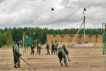 Tyumen, Russia - August 6, 2017: International Army Games. Safe Route contest. Engineers with mine detectors move and make a pass
