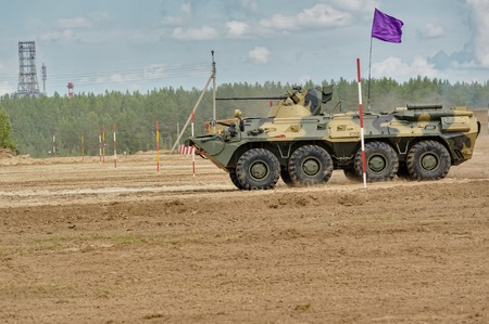 infantryman: Tyumen, Russia - June 21, 2017: Army Games. Safe Route contest. The BTR-82 amphibious armoured personnel carrier in action