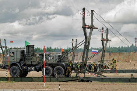 Tyumen, Russia - August 6, 2017: International Army Games. Safe Route contest. Assemblage of the mechanized bridge from TMM set Redakční
