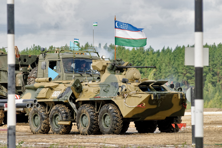 infantryman: Tyumen, Russia - August 6, 2017: International Army Games. Safe Route contest. The BTR-82 amphibious armoured personnel carrier in action Editorial