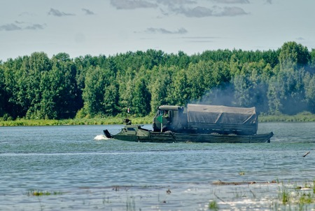 Tyumen, Russia - August 4, 2017: International Army Games. Engineering Formula contest. Equipment transportation across a water obstacle tracked amphibious carrier PTS