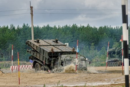 Tyumen, Russia - August 6, 2017: International Army Games. Safe Route contest. Motion of the mechanized bridge from TMM set Redakční