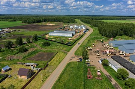 Aerial view onto modern machine yard of agricultural firm. Sverdlovsk region