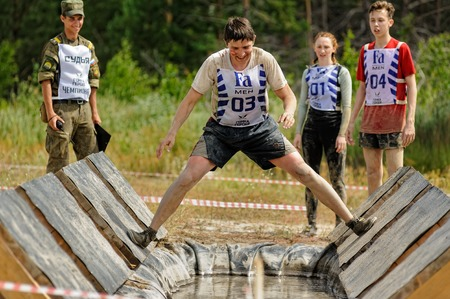 Tyumen, Russia - July 1, 2017: Race of Heroes project on the ground of the highest military and engineering school. Participants carry out anti-gravitation exercise