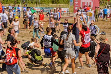 tough: Tyumen, Russia - July 5, 2017: Race of Heroes project on the ground of the highest military and engineering school. Russian army obstacle course race