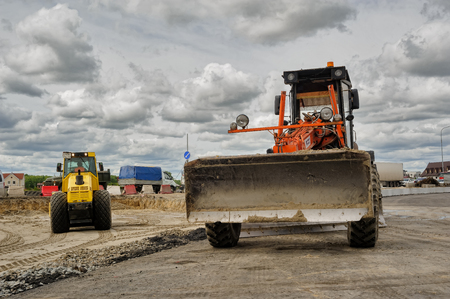 Tyumen, Russia - June 1, 2017: JSC Mostostroy-11. Construction of two-level outcome on bypass road on Fedyuninskogo and Permyakova streets intersection. Bulldozer works