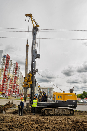 TTyumen, Russia - June 1, 2017: JSC Mostostroy-11. Construction of two-level outcome on bypass road on Fedyuninskogo and Permyakova streets intersection. Diesel pile driving machine