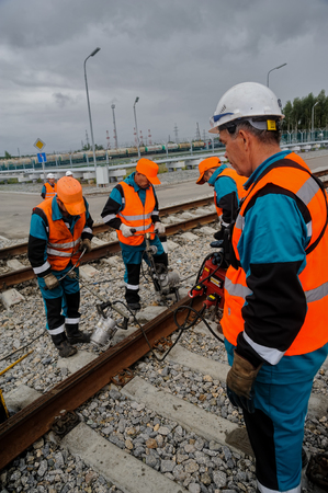 Tobolsk, Russia - July 13. 2016: Sibur company railway workers repairing way