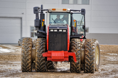 Tyumen, Russia - April 04. 2014: IV Agricultural Machinery and Equipment Tyumen specialized exhibition. Test-drive of tractor on special dirt range Editorial
