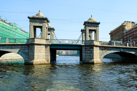 Saint-Petersburg, Russia - May 13, 2006: Lomonosov Bridge through Fontanka River. Lomonosov Bridge is the best preserved of towered movable bridges typical for Saint Petersburg in 18th century