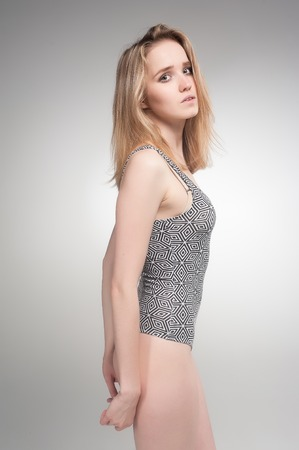 Young beautiful fashionable deplorable model over grey background