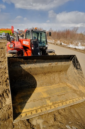 Tyumen, Russia - April 04. 2014: IV Tyumen specialized exhibition Agricultural Machinery and Equipment. Test-drive of plow tractor on special dirt range