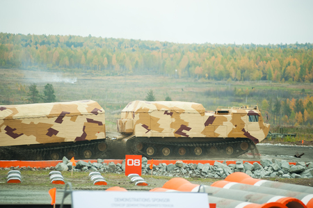 Tracked carrier on demonstration range leaving after overcoming the water fort.