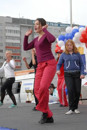 Tyumen, Russia - October 6, 2007: City Day of Health. Dancing girls near shopping center