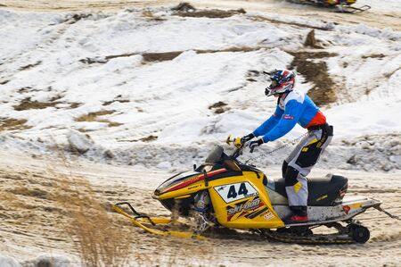 Tyumen, Russia - March 08. 2008: IV stage of personal-team Championship of Ural Federal district in over-snow cross-country. Snowmobile rider on sport track