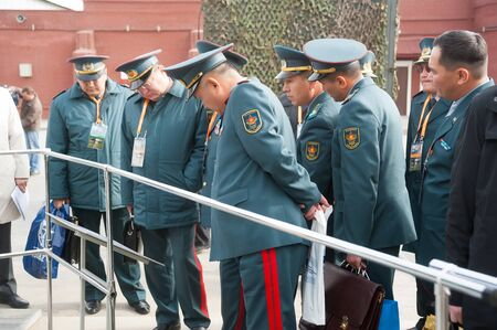 Nizhniy Tagil, Russia - September 25. 2013: Officers of Kazakh army examine armored troop-carrier. RAE-2013 exhibition. Russian Arms Expo