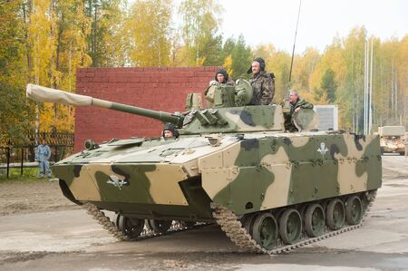 Nizhniy Tagil, Russia - September 25. 2013: Airborne tracked armoured personnel carrier BMD-4M with additional protection on demonstration range. Russia Arms Expo-2013 exhibition Editöryel