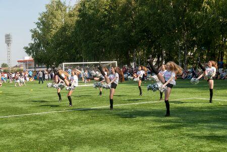 Tyumen, Russia - January 3, 2018: Football tournament among kindergartens at Geolog stadium. Cheerleaders in action Redactioneel
