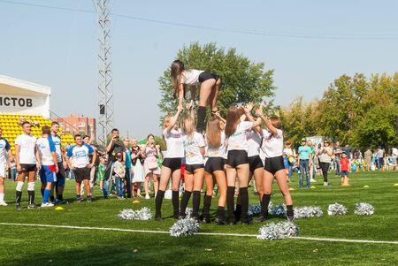 Tyumen, Russia - January 3, 2018: Football tournament among kindergartens at Geolog stadium. Performance of beautiful young girls of cheerleader team Redactioneel