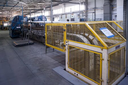 Bogandinskiy, Russia - April 20, 2018: Stekloteh factory on bottles production. Automated line for the production of glass containers Editorial