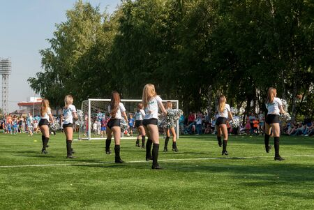 Tyumen, Russia - January 3, 2018: Football tournament among kindergartens at Geolog stadium. Performance of beautiful young girls of cheerleader team Stockfoto - 128834596