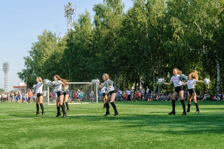 Tyumen, Russia - January 3, 2018: Football tournament among kindergartens at Geolog stadium. Performance of beautiful young girls of cheerleader team Stockfoto - 128834597