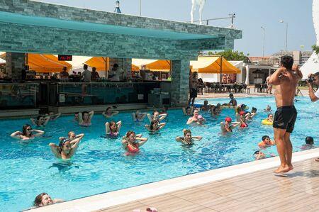 Turkler, Turkey - July 30, 2018: Pool in Senza hotel. Women doing fitness exercises Editoriali