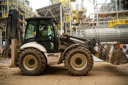 Tobolsk, Russia - May 29. 2018: Sibur company. Construction of plant on processing of hydrocarbons. Wheel loader Editorial