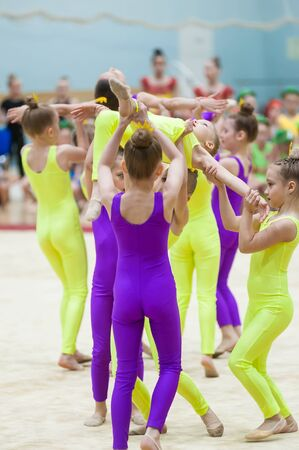 Tyumen, Russia - May 27, 2018: Priboy superiority of Olympic reserve school for children and young people on rhythmic gymnastics in Stroymash sports complex. Show program of young gymnasts team Stock Photo - 128834982