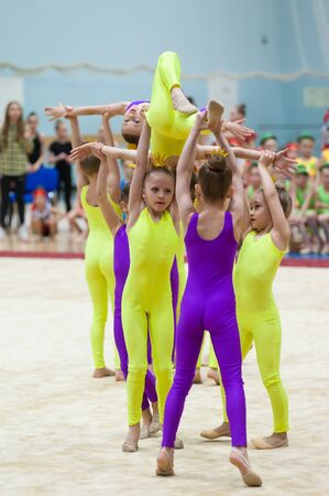 Tyumen, Russia - May 27, 2018: Priboy superiority of Olympic reserve school for children and young people on rhythmic gymnastics in Stroymash sports complex. Show program of young gymnasts team