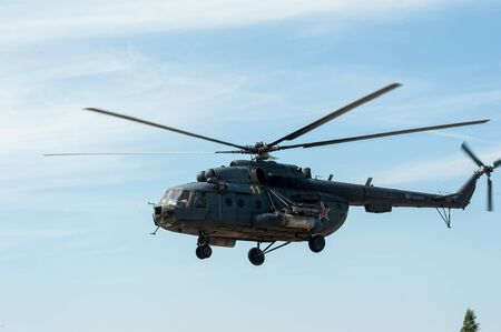 Tyumen, Russia - June 23, 2017: Army Games. Engineering Formula contest. Highest military and engineering school ground. Military helicopter MI-8 at small height Editorial