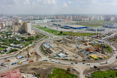 Tyumen, Russia - July 29, 2016: Construction of two-level outcome on bypass road on Fedyuninskogo and Melnikayte streets intersection