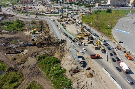 Tyumen, Russia - July 27, 2016: Construction of two-level outcome on bypass road on Fedyuninskogo and Melnikayte streets intersection Editorial