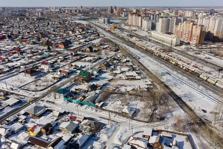 Tyumen, Russia - March 11, 2016: The railroad along 50 let VLKSM Street, dividing old and new districts of the city Editorial