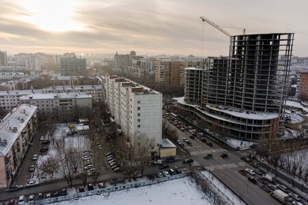 Tyumen, Russia - November 13, 2015: Aerial view on residental house construction site and building of Sberbank of Russia. Profsoyuznaya and Eletskaya streets intersection Editorial