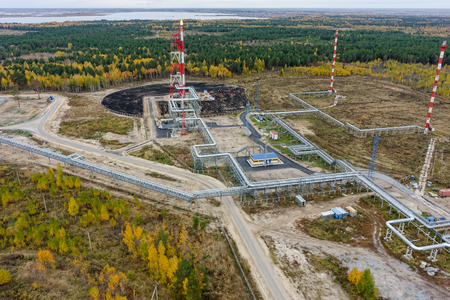 Bird eye view onto torches for burning of associated gas of Antipinsky oil refinery