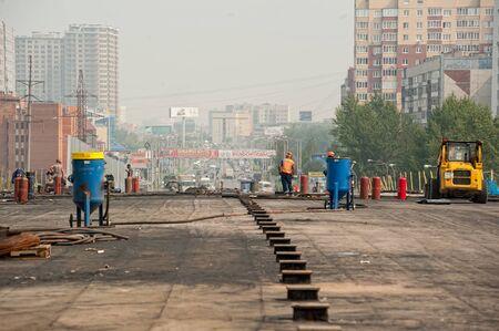 Tyumen, Russia - July 31, 2013: JSC Mostostroy-11. Bridge construction on Melnikayte street through Shirotnaya street Editorial