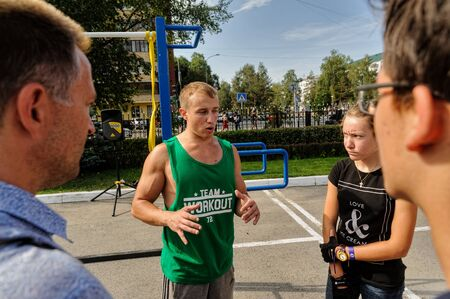 Tyumen, Russia - August 26, 2016: Open Day of Sberbank for children. Street workout show Editorial