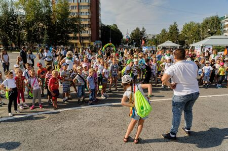 Tyumen, Russia - August 26, 2016: Open Day of Sberbank for children. The animator entertains children in show program Éditoriale