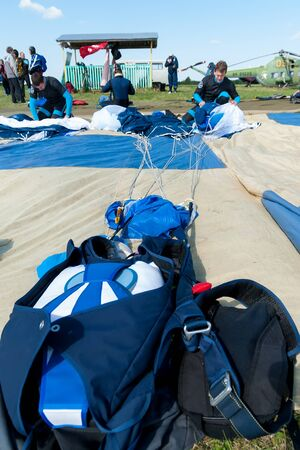 Yalutorovsk, Russia - May 24, 2008: Competition of parachutists on landing accuracy on sport airdrome. Preparations of parachutists for a new jump