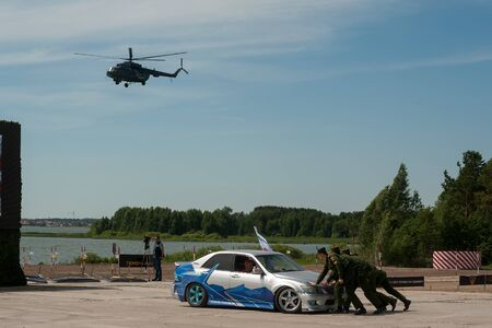 Tyumen, Russia - June 23, 2017: Army Games. Engineering Formula contest. Highest military and engineering school ground. Drifting cars show. Evacuation of the decayed car
