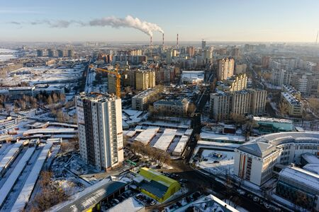 Tyumen, Russia - December 2, 2015: Aerial view on Aurora residential area construction with combined heat and power factory on background