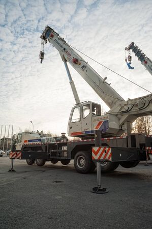 Tyumen, Russia - October 18, 2012: Architecture and Construction exhibition in Showroom. Construction crane on open area