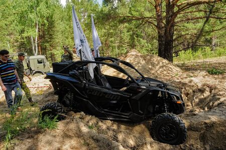 Tyumen, Russia - June 11, 2016: Race of Heroes project on the ground of the highest military and engineering school. ATV got stuck on the sandy road