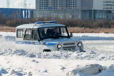 Tyumen, Russia - February 22, 2015: Ice autodrome Ice cult on Alebashevo lake. Competitions for police officers Special operation Ice. Offroad car race Editorial
