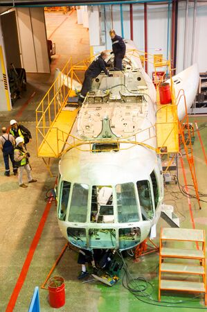 Tyumen, Russia - June 5, 2019: Aircraft repair helicopter UTair Engineering plant. Mi-8 helicopter during maintencance and repair at the service hangar Editorial