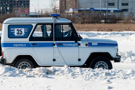 Tyumen, Russia - February 22, 2015: Ice autodrome Ice cult on Alebashevo lake. Competitions for police officers. Special operation Ice. Offroad car race Editorial